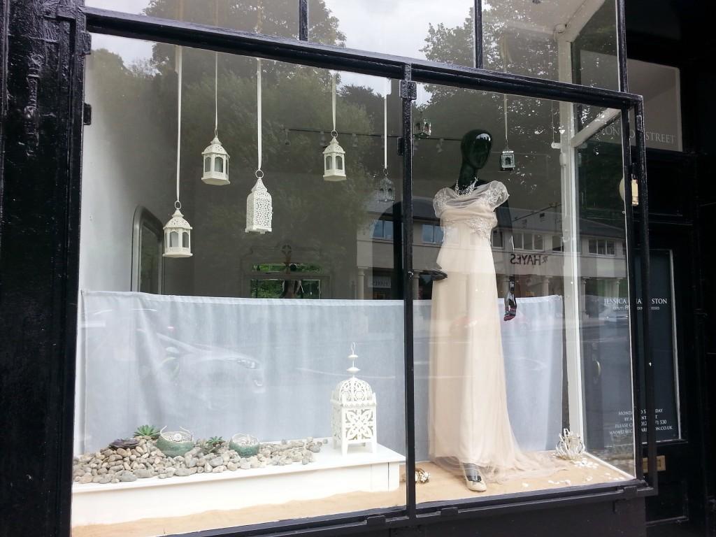 Twelve window displays in bath wedding dress shop for How to display a wedding dress