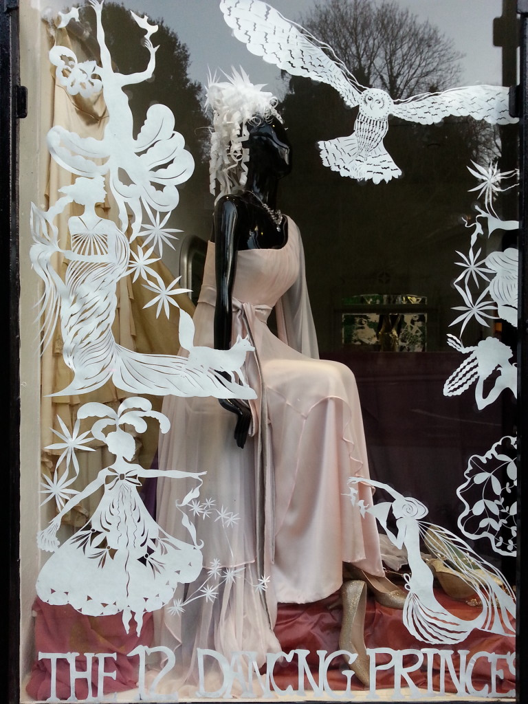 Nenuphar Dress in window with paper cuts